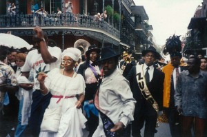 The Krewe of Zulu dancing down the French Quarter