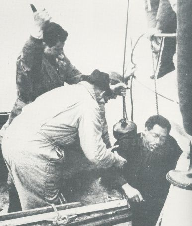 The body of Otis Redding being recovered out of the icy waters of Lake Monona in Madison, WI; he was still strapped in his seat (Courtesy: StreamingOldies.com)