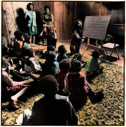 yoko ono teaching members of the harlem community choir the lyrics to happy christmas war is over at the record plant new york city courtesy yoko ono - John Lennon Christmas Songs
