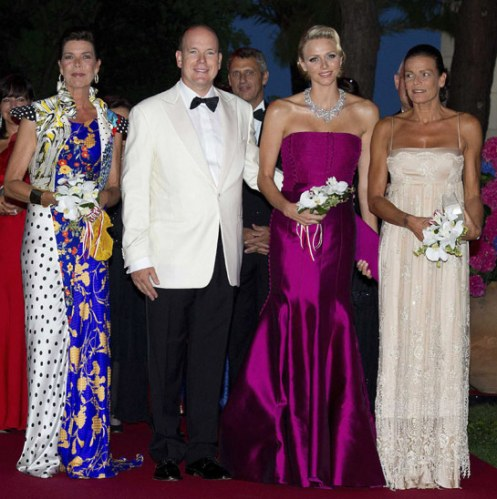 Princess Caroline, Prince Albert, Princess Charlene and Princess Stephanie of Monaco taking their bows at The Red Cross Ball last week. Sorry, but the Grimaldi women do not look their best; marriage and relationships, as the family curse has proven, is not their best friend (Courtesy: Hello! Magazine)