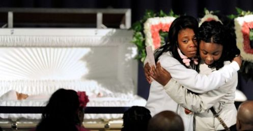 Grief at Jonylah's coffin: her mother Judy and a relative (Courtesy: Paul Beaty)