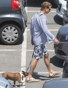 Andrea Casiraghi, 28, trying hard to look like any other rich young man walking the dog down a Monaco street (Courtesy: Celebitchy)
