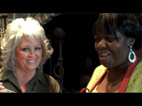 Dora Charles, now 58, working with Southern chef Paula Deen in a  still from a You Tube video; Deen once said that she would have been  devastated if she had lost Charles.  I just wonder though, who really owns those recipes that Deen is famous for? (Courtesy: You Tube)