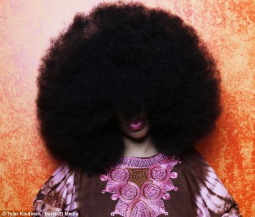 Aevin Dugas, 37, showing off her big Afro; she spent  14 years growing her tresses to the max (Courtesy: Daily Mail)
