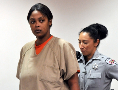 Antoinette Davis is escorted into court during a hearing  in  October 2010; she will not face the death penalty for prostituting  her daughter Shaniya Davis to Mario Andrette McNeill  (Courtesy: SpillDaBeanz.com)