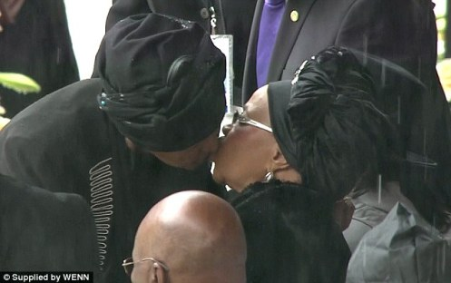 They may have been divorced, they may have been political rivals, but Nelson and Winnie Mandela still had a bond with her former husband, a bond reflected with this kiss between Winnie and  Graca Machel, his widow.  Some have called them Nelson's co-wives, and perhaps they were (Courtesy: